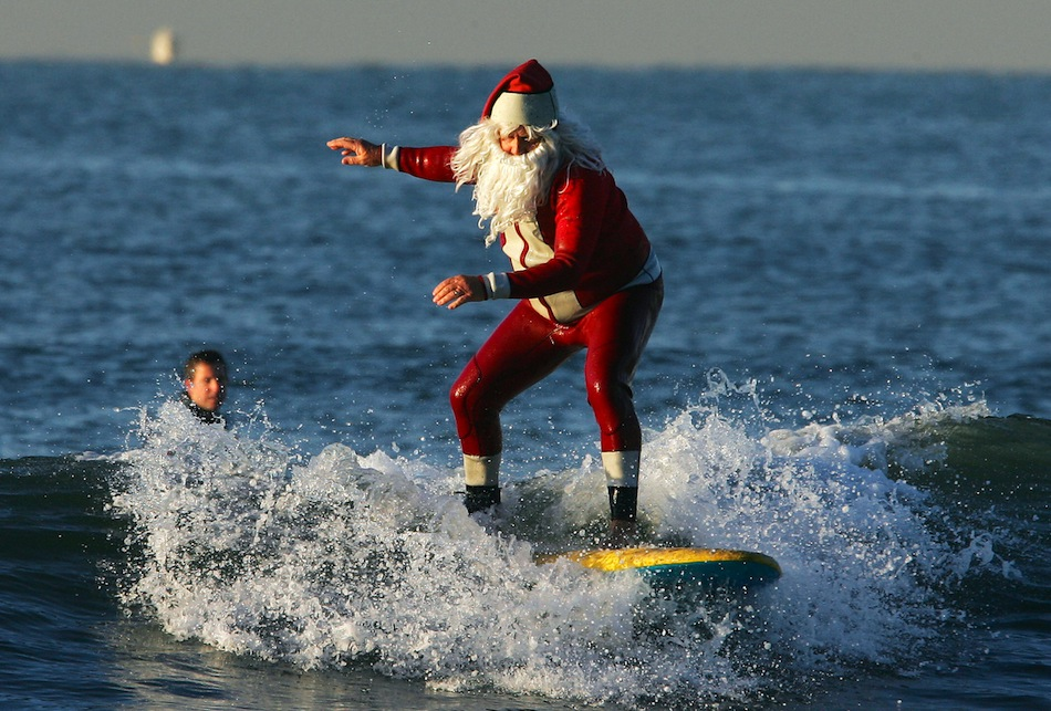 Micheal Pless, dressed in a Santa wetsui