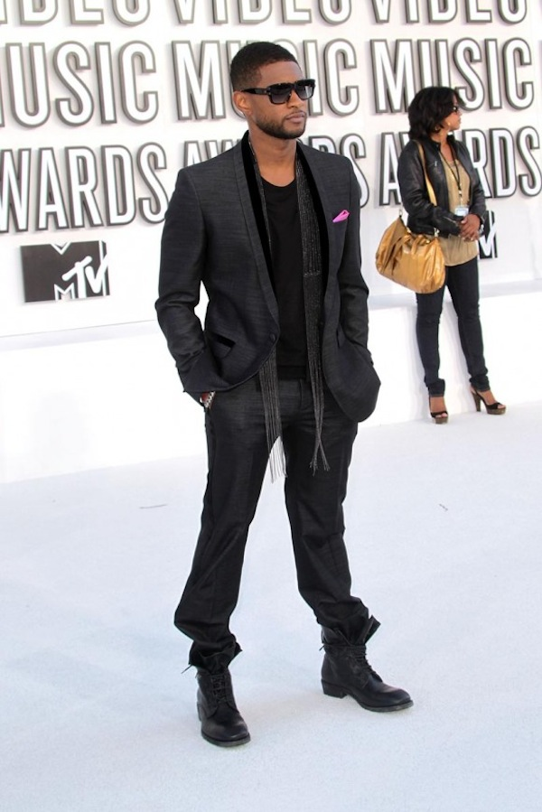 Casual jeans, boots, scarf and pocket square. Usher dude!