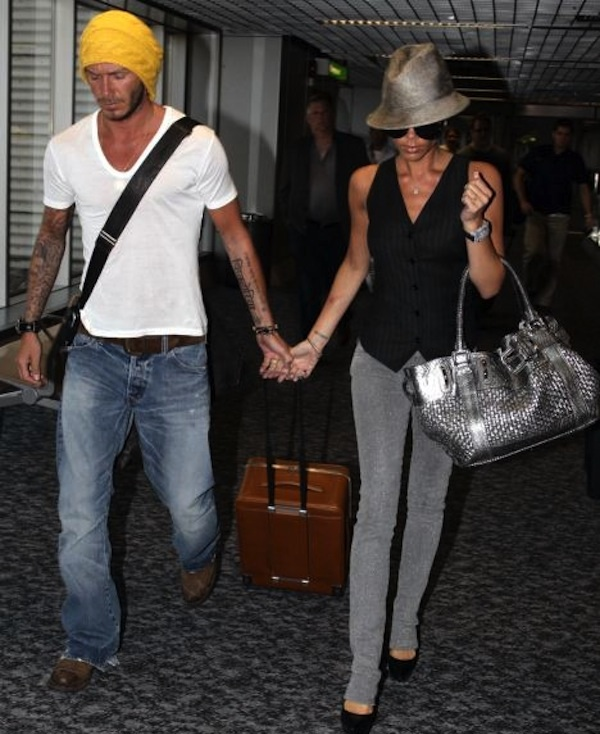 David Beckham and Victoria can't decide who driving the wheelie.